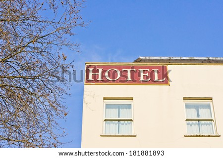 Sign on the corner of a hotel in London - stock photo