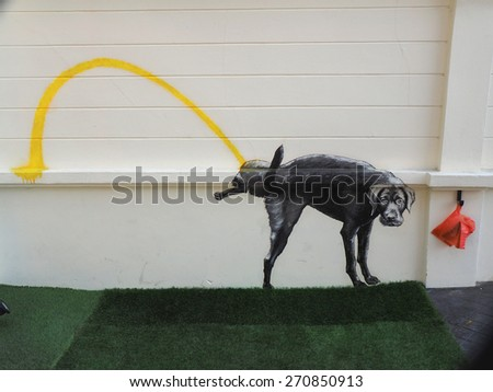 Sign on the wall for a dog toilet in Bangkok          - stock photo