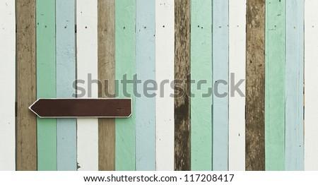sign on wood panel wall - stock photo