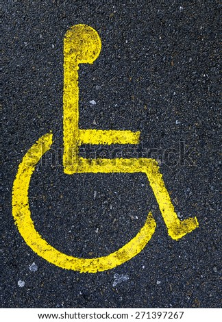 Sign painted on asphalt forbidden to park in handicapped zone - stock photo
