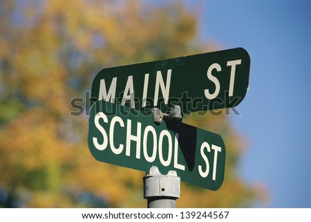 Sign post at the corner of Main St. and School St. - stock photo