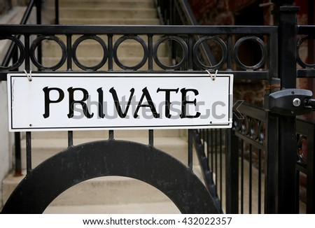 Sign PRIVATE on metallic gate with lock - stock photo