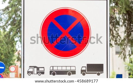 sign Prohibition of parking and stopping heavy vehicles: Vans, Buses and Trucks - stock photo