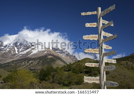 Sign showing the directions and hiking trails in Torres del Paine National Park, Chile, Patagonia. - stock photo