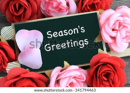 sign showing the message of Season's Greetings - stock photo