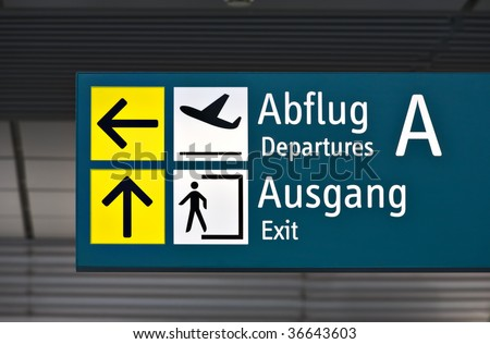 sign to departure area and exit at german airport - stock photo