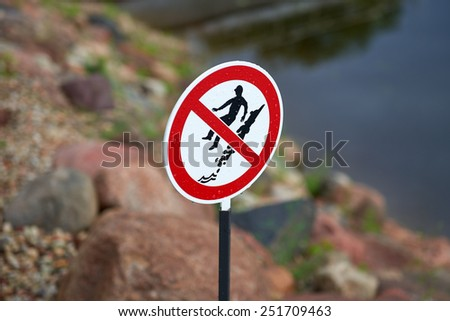 Sign to warn people of the danger of deep water and cliff edge - stock photo
