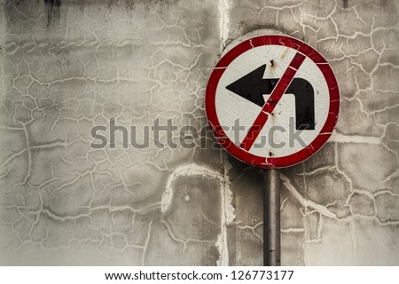 """Sign Warning """"Don't turn Left"""" Sign Warning at the Wall end of a road. - stock photo"""