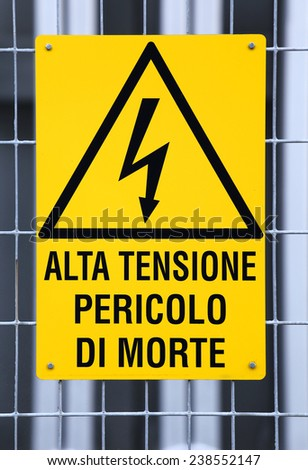 sign with potentially fatal HIGH VOLTAGE in an industrial plant - stock photo