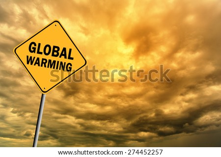 Sign with words 'Global warming' on a background of thunderclouds in warm tones - stock photo