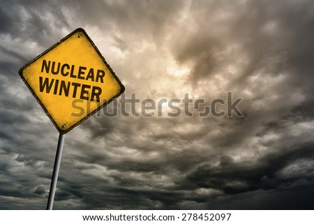 Sign with words 'Nuclear winter' on a background of thunderclouds with vignette effect - stock photo