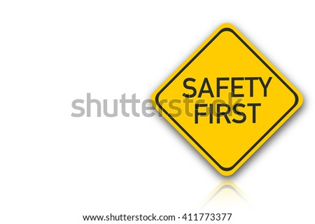 Sign with words Safety First on white Background - stock photo