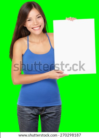 Sign woman holding showing white blank paper placard. Smiling happy young asian girl in tank top Isolated on green screen chroma key background. - stock photo
