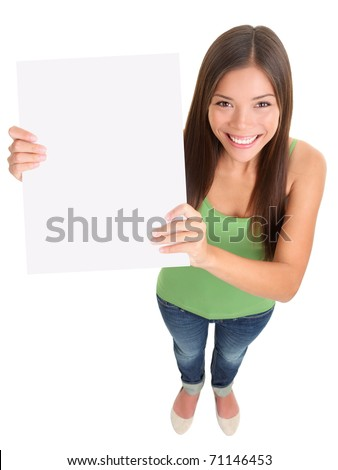 Sign woman smiling. Top view of multi-ethnic girl showing blank empty sign board with copy space for text message. Mixed-race Asian Caucasian female model cut out in full length on white background. - stock photo