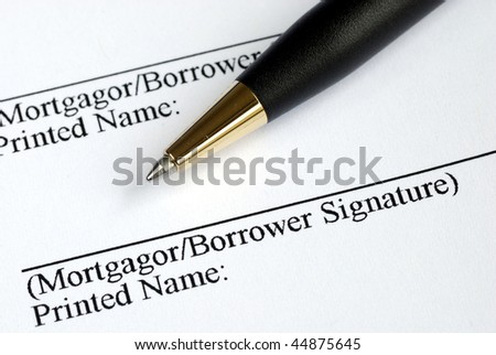 Sign your name here on the mortgage application - stock photo