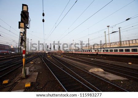 Signal and tracks in a German rail yard - stock photo