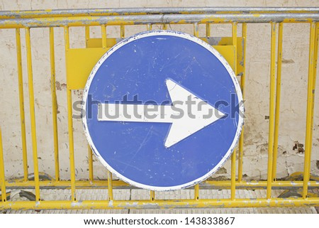 Signal direction with mesh protection in urban street traffic signage - stock photo