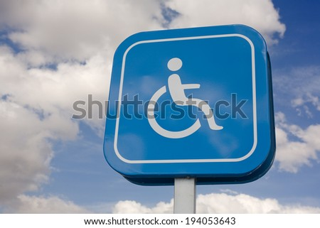 Signal that indicate priority parking for vehicles of people with disabilities - stock photo