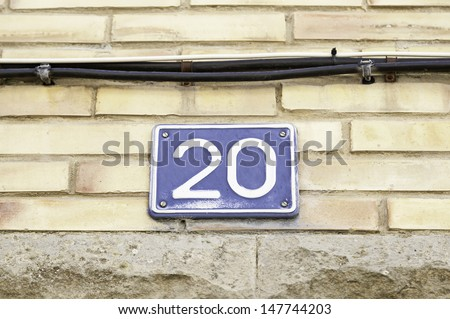 Signal with number twenty, detail of an old metal plate with the number twenty, symbol and information - stock photo