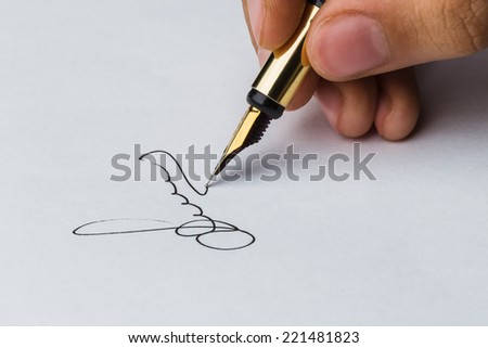 Signature of a fountain pen on white paper - stock photo