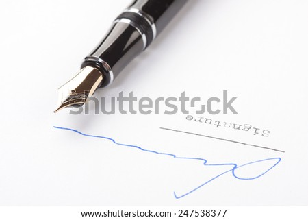 Signature on white paper with old fountain pen - stock photo