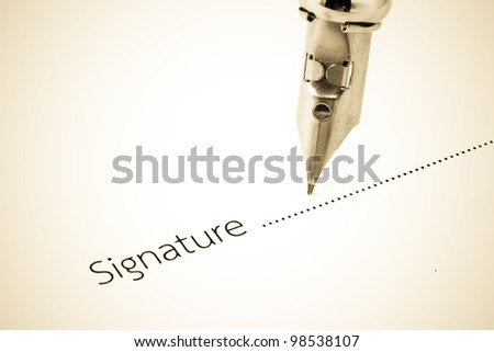 Signature with a fountain pen - stock photo