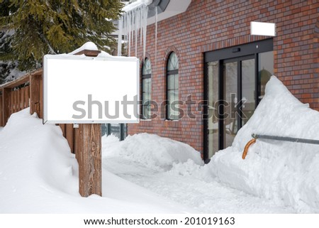 signboard in snow - stock photo