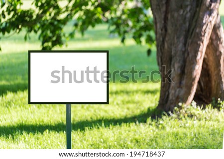 Signboard mockup in the park ready for branding identity and hipster logo drawing - stock photo