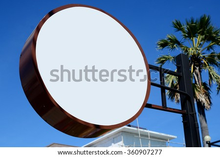 Signboard on blue sky - stock photo