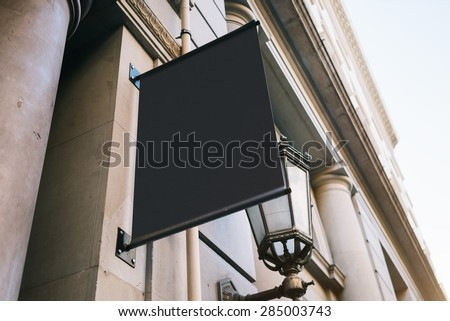 Signboard on the wall - stock photo