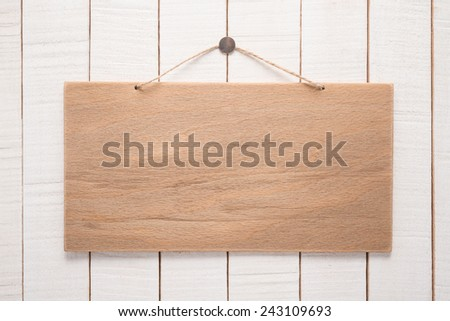 Signboard with rope on wooden background   - stock photo