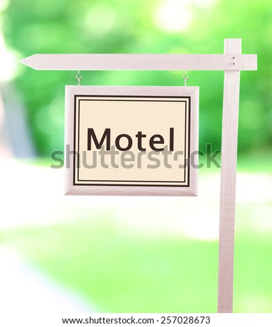 Signboard with text Motel - stock photo