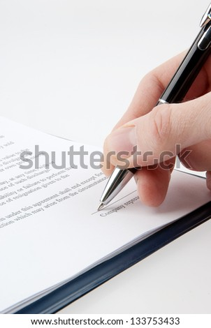 Signing a contract - stock photo
