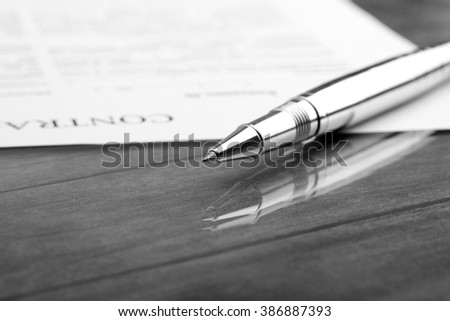 signing a contract, business contract details. Black and white filter - stock photo