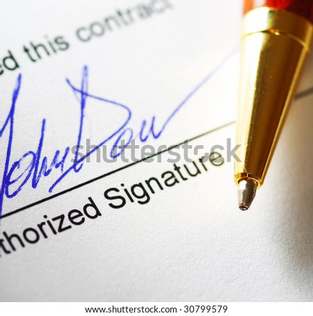 Signing a contract. Shallow depth of field. - stock photo