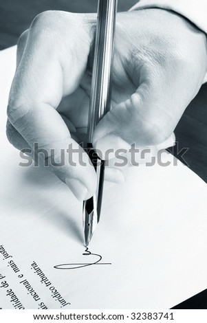 Signing a document - stock photo