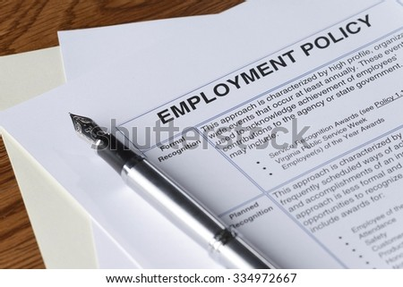 signing an employment policy document - stock photo