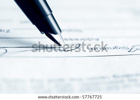 Signing contract. - stock photo