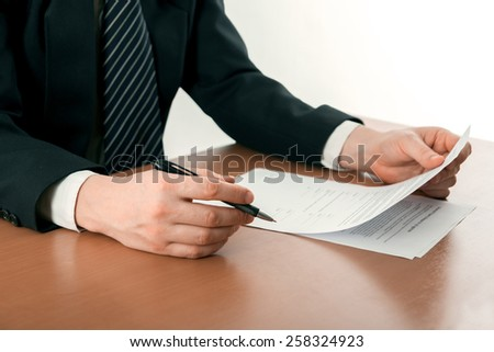 Signing papers. Lawyer, realtor, businessman sign documents.  - stock photo