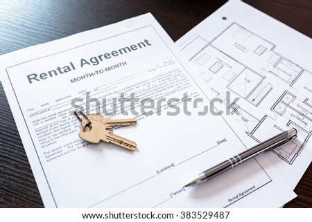 Signing rental agreement contract - stock photo