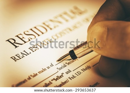 Signing Residential Real Estate Contract Closeup Photo. Real Estate Business Concept. - stock photo