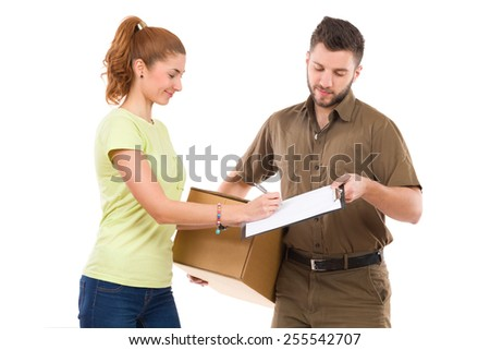 Signing the document. Woman receives a package and signing a document. Waist up studio shot isolated on white. - stock photo