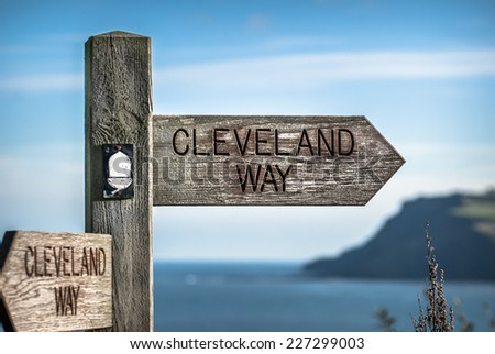 Signpost for the cleveland way coastal walk in North Yorkshire near Robin Hood's Bay. - stock photo