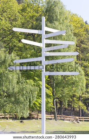 Signpost in a park or forested area - stock photo
