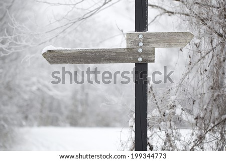 signpost in winter - stock photo