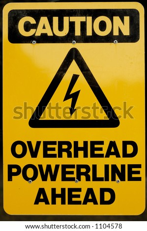 signpost of Overhead Power-line Ahead - stock photo