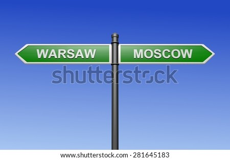 Signpost with arrows pointing two directions - towards Warsaw and Moscow.  - stock photo
