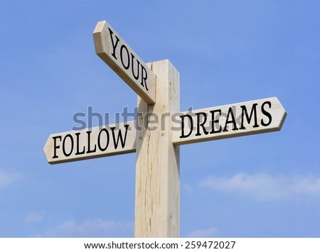 """Signpost with the words """"Follow Your Dreams"""" over a blue sky background - stock photo"""
