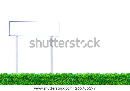 Signs for writing text on green grass. - stock photo