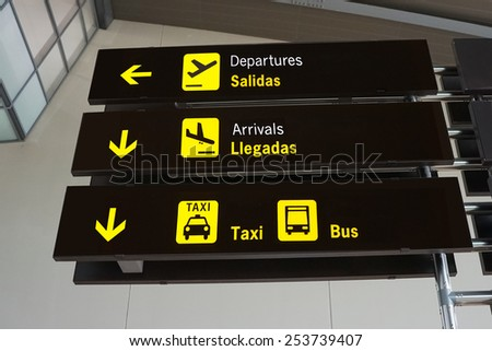 Signs Inside an International Airport - stock photo